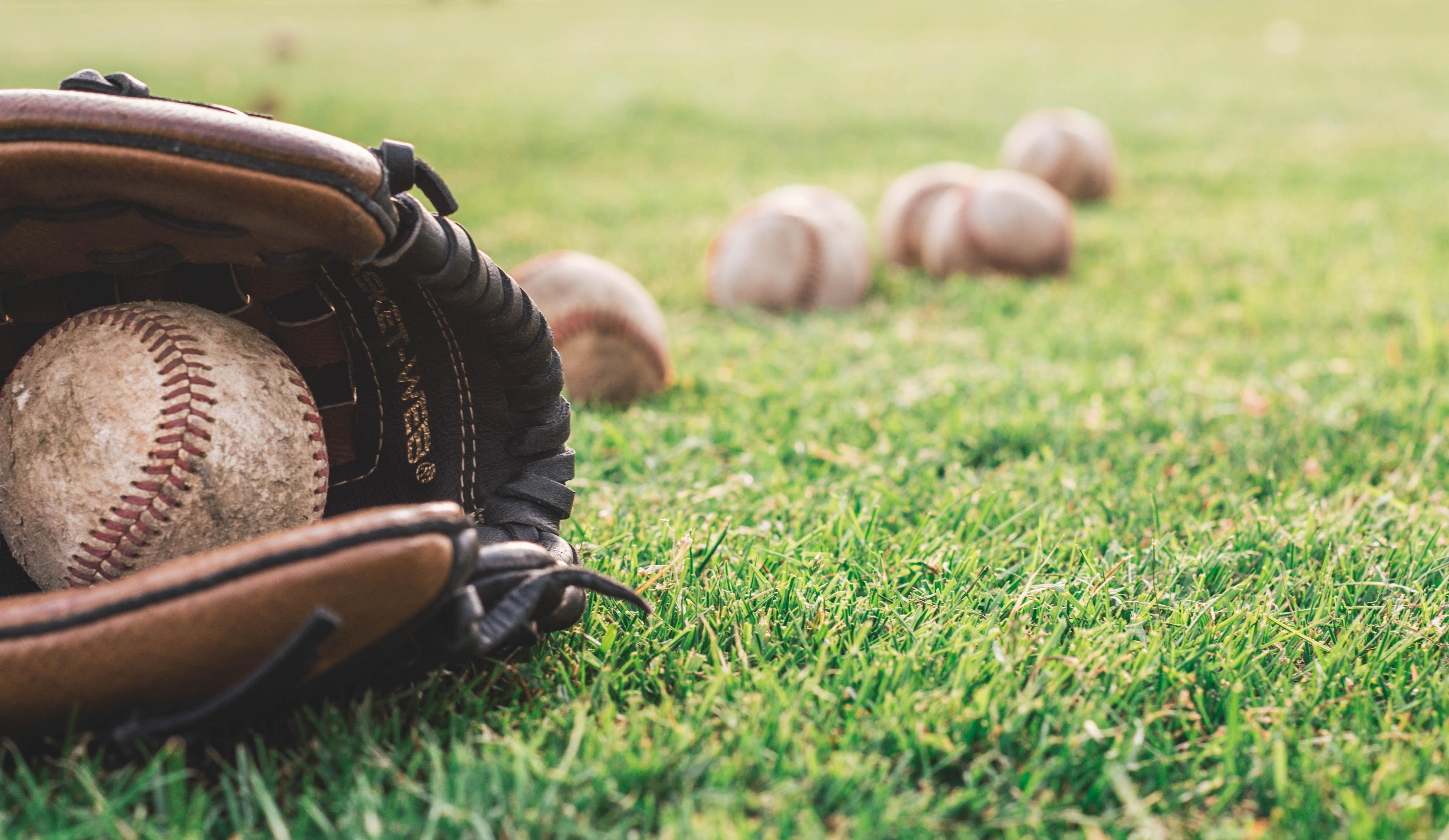 white-baseball-ball-on-brown-leather-baseball-mitt-1661950